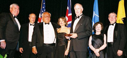 Roger Brody accepting Philatelic Achievement Award for George Brett; left to right, Postmaster General John Potter, NPM Director Allen Kane, Mr. & Mrs. Arthur Morowitz, USSS Chairman Roger Brody, Mr. & Mrs. Harvey Bennett.
