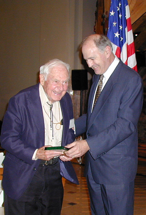 George Brett (left) receives his citation for induction in to the United States Stamp Society/Bureau Issues Association Hall of Fame from Chairman Roger Brody.